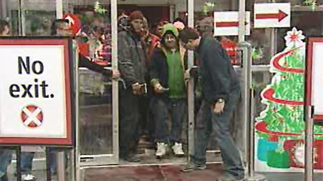 Customers rush into Future Shop at 5 a.m. on Dec. 26.