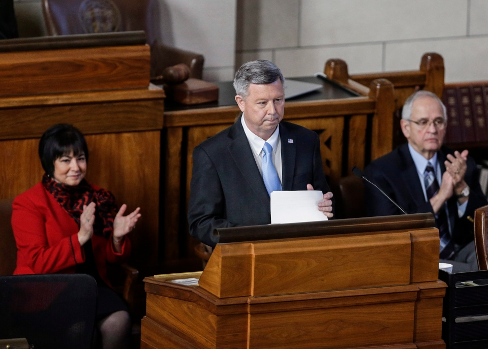 Nebraska Gov. Dave Heineman is applauded by first lady Sally Ganem, left, and Sen. John Harms of Scottsbluff, right, at the conclusion of the annual State of the State address to lawmakers in Lincoln, Neb., Tuesday, Jan. 15, 2013. (AP / Nati Harnik)