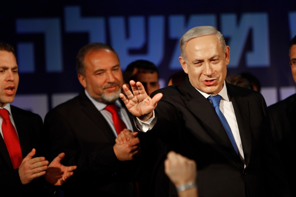 Israel's Prime Minister Benjamin Netanyahu, right, and former Foreign Minister Avigdor Lieberman greet their supporters in Tel Aviv, Israel, Wednesday, Jan. 23, 2013. (AP / Oded Balilty)