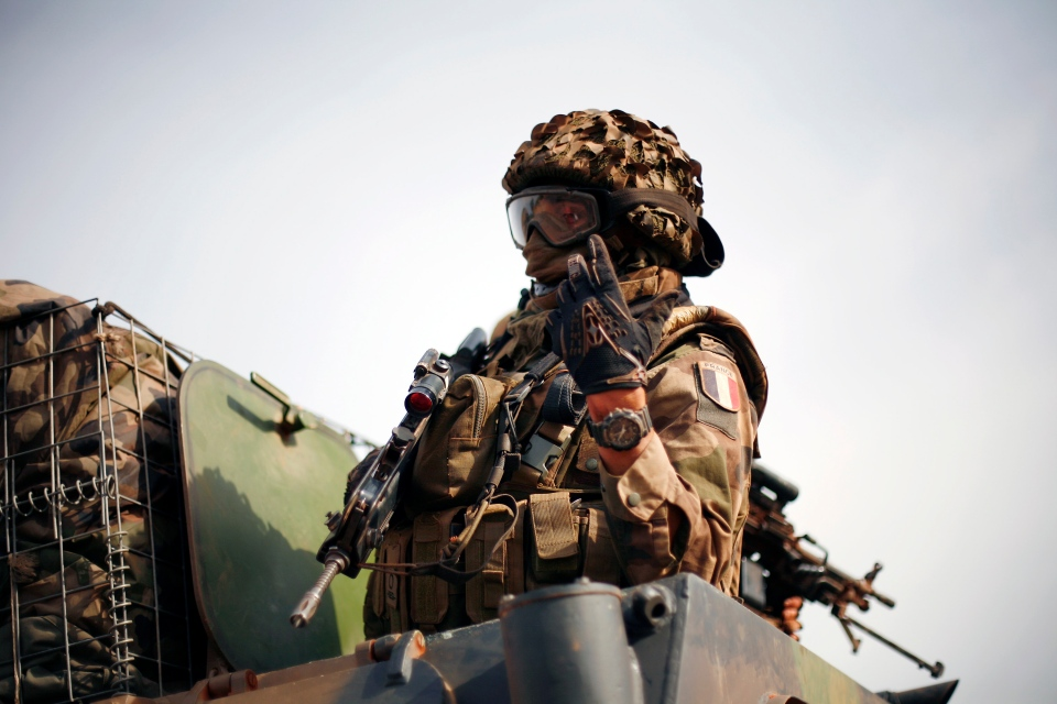 A convoy of French soldiers drives north as they pass through Segou, central Mali, some 240 kilometres from Bamako Tuesday, Jan. 22, 2013. (AP / Jerome Delay)