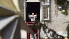 Pope Benedict XVI delivers his blessing during the Angelus noon prayer he celebrated from the window of his studio overlooking St. Peter's square at the Vatican, Sunday, Dec. 26, 2010. (AP / Andrew Medichini)
