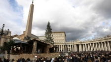 People gather in St. Peter's square at the Vatican as Pope Benedict XVI delivers his blessing during the Angelus noon prayer he celebrated from the window of his studio, Sunday, Dec. 26, 2010. (AP / Andrew Medichini)