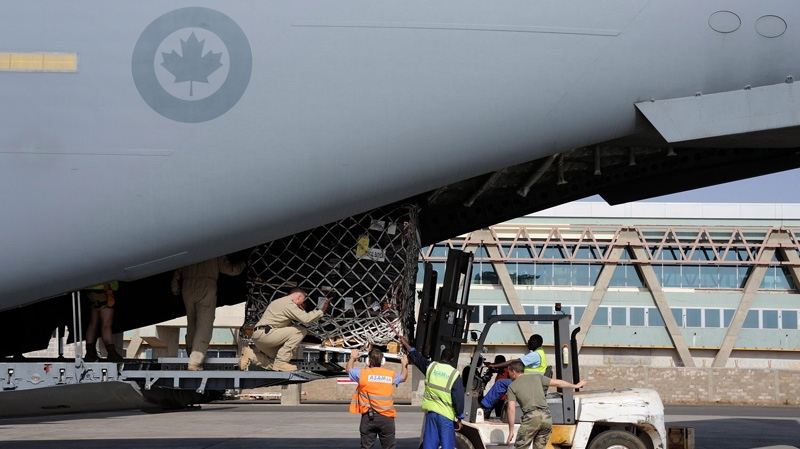 Canadian Forces C-17 Globemaster III Loadmaster Corporal Todd Marshall directs the ground loading crew as they remove a pallet of medical supplies from the C-17 using a forklift upon their arrival in Bamako, Mali, on Thursday, Jan. 17, 2013. (Department of National Defence-Sergeant Matthew McGregor, Canadian Forces Combat Camera)