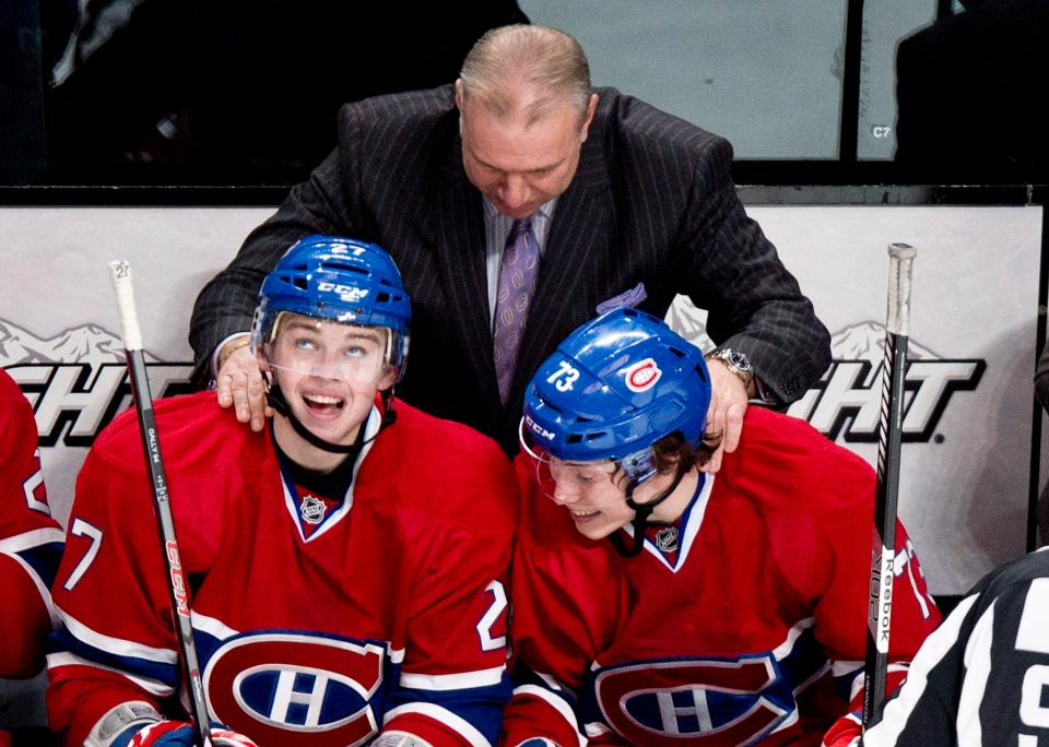 Montreal Canadiens Michel Therrien congratulates Alex Galchenyuk, left for his first NHL goal and teammate Brendan Gallagherfor his assist on the goal as they face the Florida Panthers during second period NHL hockey action Tuesday, January 22, 2013 in Montreal. THE CANADIAN PRESS/Paul Chiasson