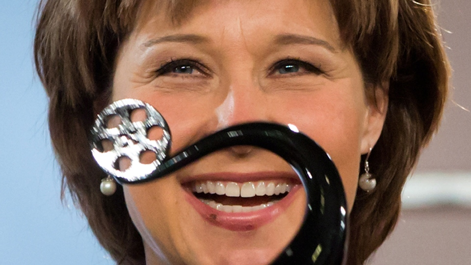British Columbia Premier Christy Clark holds up a trophy during an event in Vancouver, B.C., on Tuesday January 22, 2013. (Darryl Dyck / THE CANADIAN PRESS)