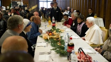 Pope Benedict XVI has a lunch inside the Vatican's main audience hall, Sunday, Dec. 26, 2010. (AP / L'Osservatore Romano)