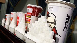 Various size cups and sugar cubes are displayed at a news conference at New York's City Hall, Thursday, May 31, 2012.  (AP / Richard Drew)