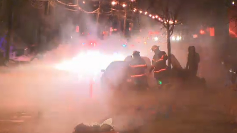 Firefighters are barely visible through mist as they deal with a water main break in Verdun (Jan. 23, 2013)