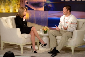 Notre Dame linebacker Manti Te'o, right, speaks with host Katie Couric during an interview in New York in this photo released by ABC. (AP Photo/Disney-ABC/Lorenzo Bevilaqua)