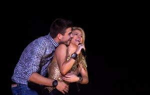 Shakira performs with FC Barcelona Gerard Pique during her 'The Sun Comes Out World Tour' concert in Barcelona, Spain. (AP / Emilio Morenatti)