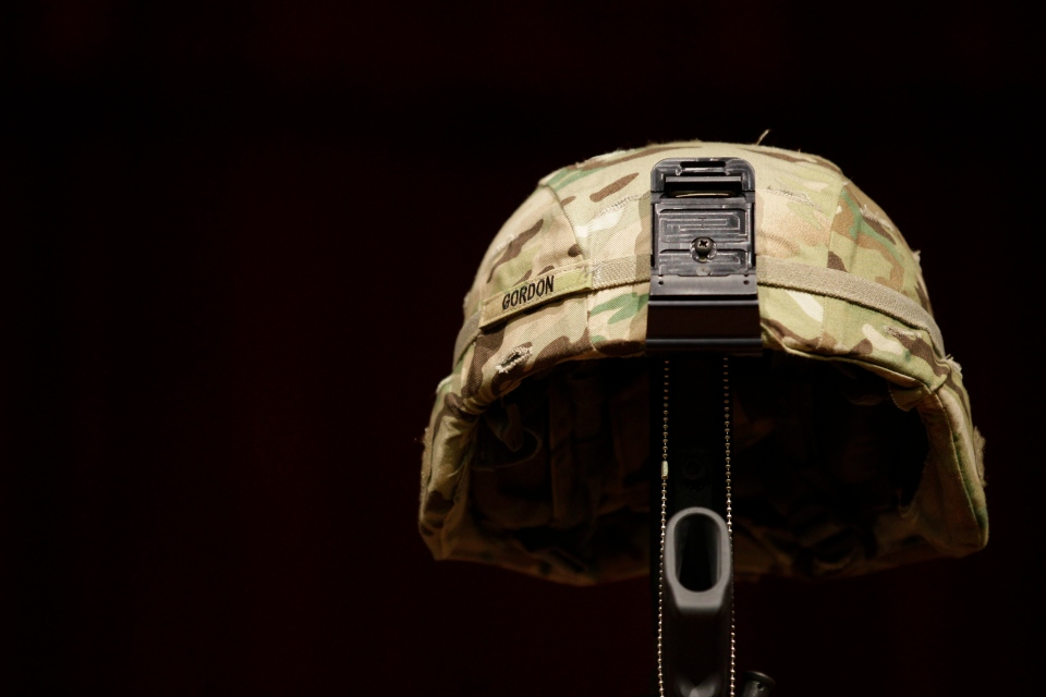 A helmet belonging to female U.S. Army soldier is displayed at a memorial service in this November 2012 file photo. (AP / Ted S. Warren)