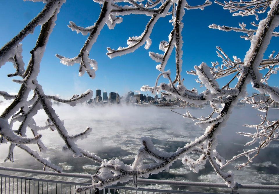 Ice fog from the St. Lawrence river blankets the city as windchill temperatures hit -38C Wednesday, Jan. 23, 2013 in Montreal. (Ryan Remiorz / THE CANADIAN PRESS)