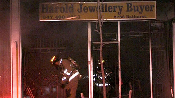 Emergency officials are seen at Harold The Jewellery Buyer at 2788 Bathurst St., near Glencairn Ave. in Toronto, Monday, Dec. 27, 2010.