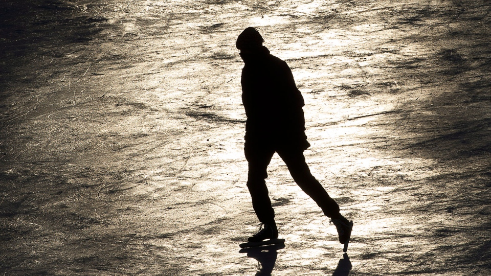 A skater cruises along the Rideau Canal braving temperatures which felt like -40 C with windchill in Ottawa, Wednesday, Jan. 23, 2013. (Adrian Wyld / THE CANADIAN PRESS)