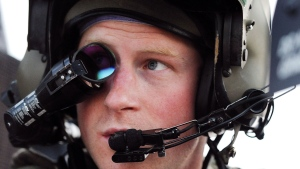 In this photo taken Dec. 12, 2012 and made available Monday Jan. 21, 2013, Britain's Prince Harry wears his monocle gun sight as he sits in the front seat of his cockpit at the British controlled flight-line in Camp Bastion southern Afghanistan.  (AP Photo / John Stillwell, Pool)