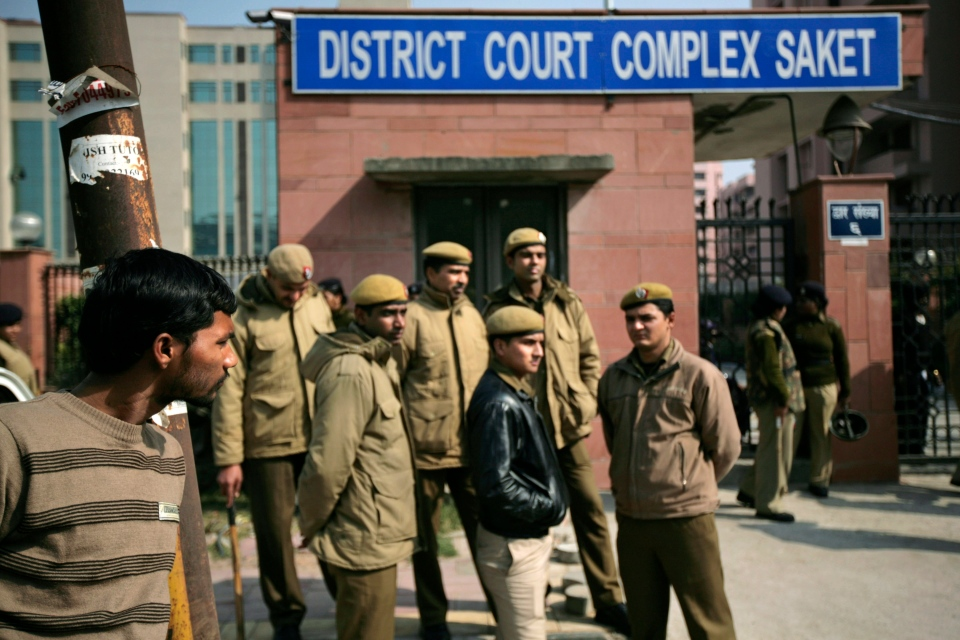 Delhi policemen stand guard near the gate of a district court where the accused in the gang rape and murder of a 23-year-old student are undergoing trial, in New Delhi, India, Thursday, Jan. 24, 2013. (AP / Altaf Qadri)
