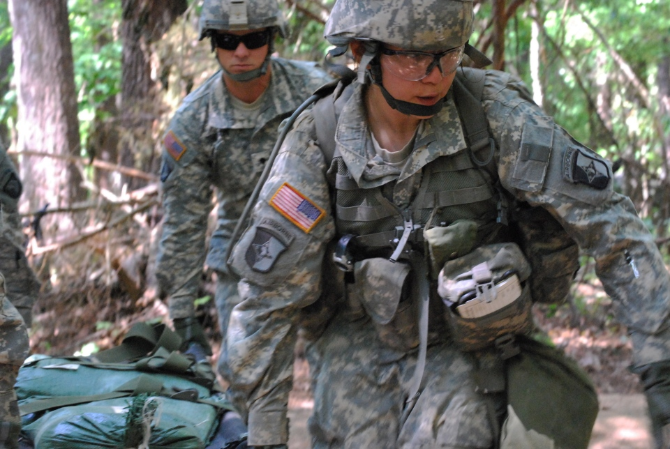 U.S. Capt. Sara Rodriguez, 26, of the 101st Airborne Division, carries a litter of sandbags during the Expert Field Medical Badge training at Fort Campbell, Ky., May 9, 2012. (AP / Kristin M. Hall)