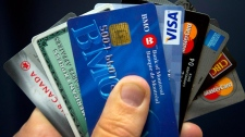 Canadians paying off debt faster