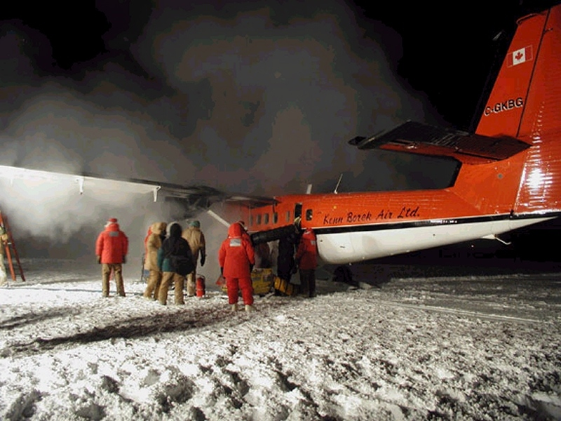 A Kenn Borek Air Twin Otter sits on a makeshift runway at the South Pole.
