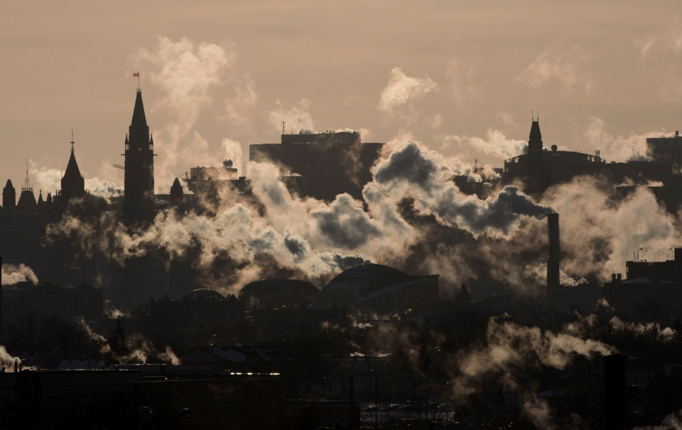 Winds blow vapour from buildings on the Ottawa skyline as temperatures hovered near -40C with windchill in Ottawa, Thursday, Jan. 24, 2013. (Adrian Wyld / THE CANADIAN PRESS)