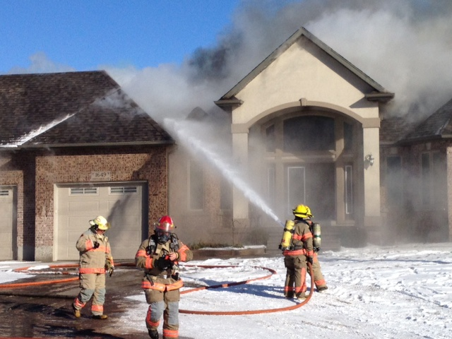 Firefighters at the scene of a house fire on Northumberland Street in Ayr, Ont., on Thursday, Jan. 24, 2013. (Kevin Doerr / CTV Kitchener)