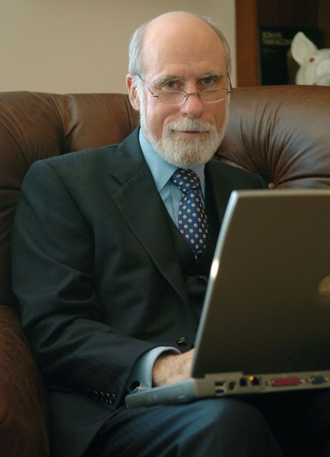 Vint Cerf works on his computer in his McLean, Va., home in this Sept. 6, 2005 file photo. (AP Photo / Kevin Wolf)