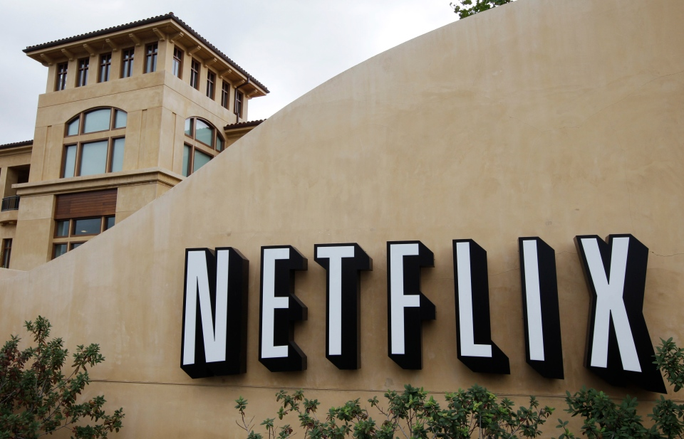 In this Oct. 10, 2011, file photo, the exterior of Netflix headquarters is seen in Los Gatos, Calif. (AP Photo/Paul Sakuma, file)