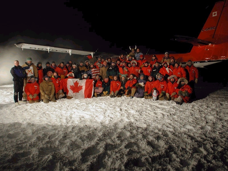 Canadian flight crew and scientists at South Pole Amundsen-Scott Research Center pose for a photo in 2001 to commemorate historic rescue mission