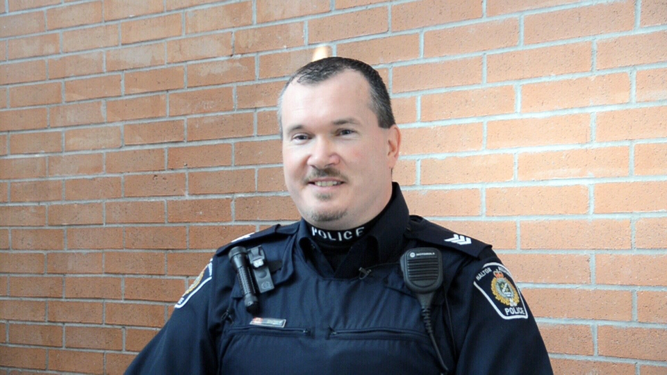 Sgt. Ryan Snow of the Halton Regional Police speaks about helping the delivery of a baby girl on the side of the 401 on Thursday, Jan. 24, 2013.
