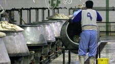 Iranian prisoners work in a kitchen in Evin prison in Tehran, Iran on June 13, 2006.