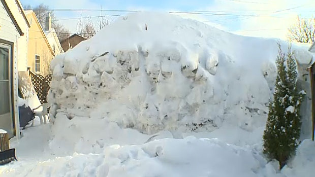 Sean Hillaby collects snow from his neighbour's driveways and builds a giant snow fort each year. He says the fort brings him and friends joy.