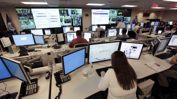 In this Sept. 24, 2010, photo the U.S. National Cybersecurity and Communications Integration Center (NCCIC) prepares for an exercise at its operations centre in Arlington, Va. (AP Photo / J. Scott Applewhite)