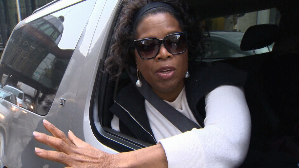 Oprah Winfrey is seen through the window of an SUV before a recent speaking appearance in Calgary. (CTV)