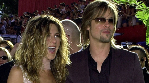 Jennifer Aniston, left, is joined by then-husband Brad Pitt as she arrives at the 54th Annual Primetime Emmy Awards Sunday, Sept. 22, 2002, at the Shrine Auditorium in Los Angeles. (AP Photo/Kim D. Johnson)