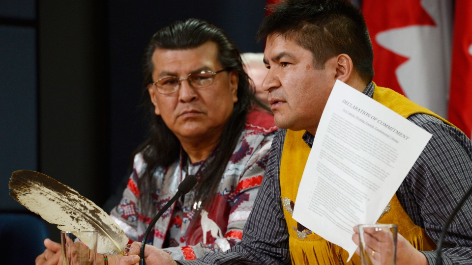 Danny Metatawabin (right), spokesperson for Attawapiskat Chief Theresa Spence, speaks at a news conference with Manitoba elder Raymond Robinson in Ottawa on Thursday, January 24, 2013. (Adrian Wyld / THE CANADIAN PRESS)