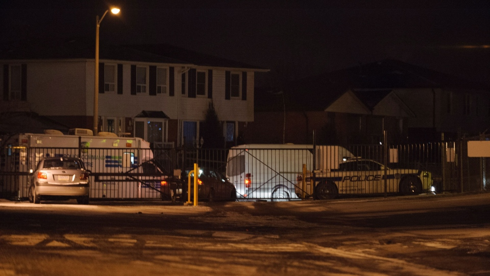 Police attend the scene of a shooting in Brampton, Ont. on Wednesday Jan. 23, 2013. (Victor Biro / THE CANADIAN PRESS)