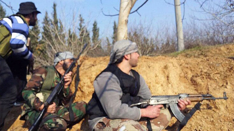 Free Syrian Army fighters take their positions during clashes with government forces in Qusair, Homs province, Syria, in this Sunday, Jan. 20, 2013 image from video. (AP / Yong Homsi Lens)