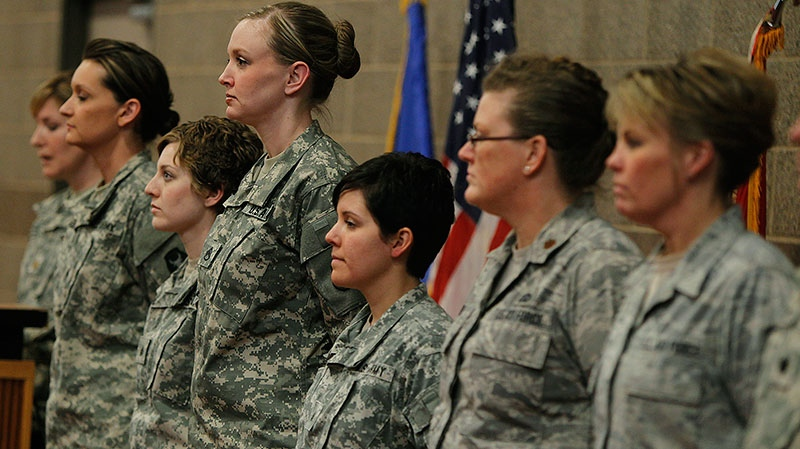 Kristen Auge, U.S. Deputy Director of Public Affairs, introduces soldiers from left, Army Sgt. 1st Class Katie Reed, Army Sgt. Cassie Mecuk, Army Staff Sgt. Andrea Drost, Army Sgt. Katie Warden, Air Force Maj. Ann Todd, and Air Force Master Sgt. Holly Caroon at the Inver Grove Heights, Minn., Training and Community Center on Thursday, Jan. 24, 2013. (The Star Tribune, Elizabeth Flores)