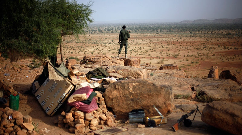 A Malian soldier stands at an observation post outside Sevare, Mali, Thursday, Jan. 24, 2013. (AP / Jerome Delay)