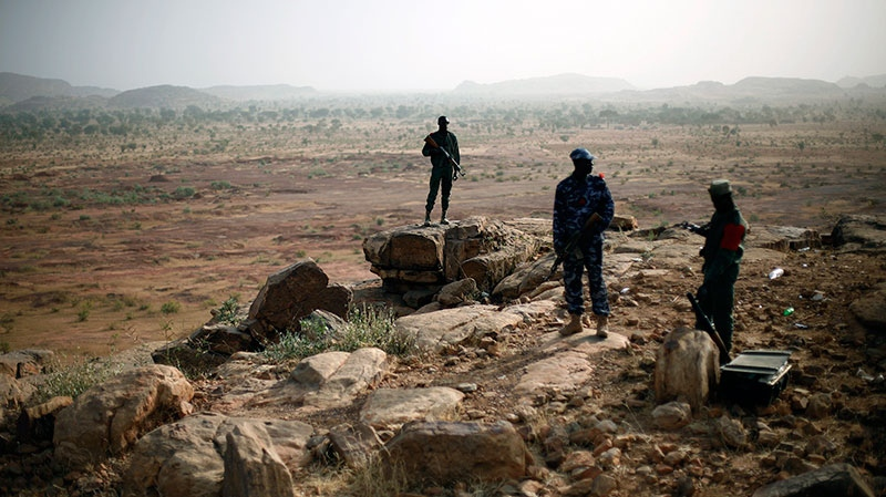 Malian troops man an observation post outside Sevare, Mali, Thursday, Jan. 24, 2013.  (AP / Jerome Delay)