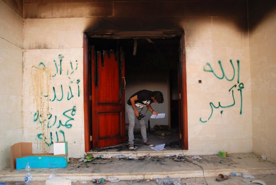 A man looks at documents at the U.S. consulate in Benghazi, Libya, after an attack that killed four Americans, including Ambassador Chris Stevens, Wednesday, Sept. 12, 2012. (AP / Ibrahim Alaguri)