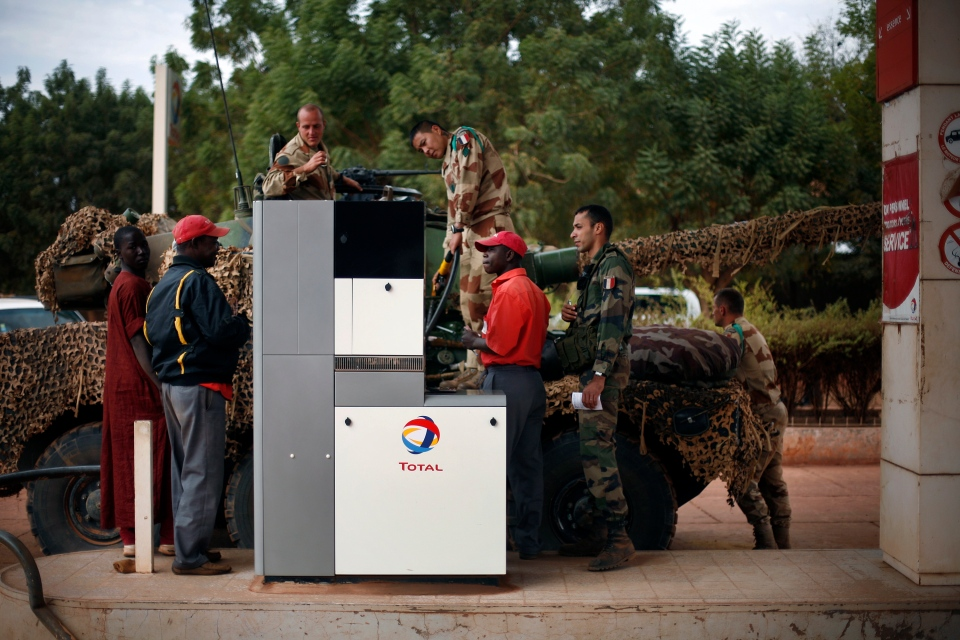 French soldiers fill up their tank at a local petrol station in Sevare, some 620 kilometers (385 miles) north of Mali's capital Bamako, Friday, Jan. 25, 2013. (AP Photo/Jerome Delay)