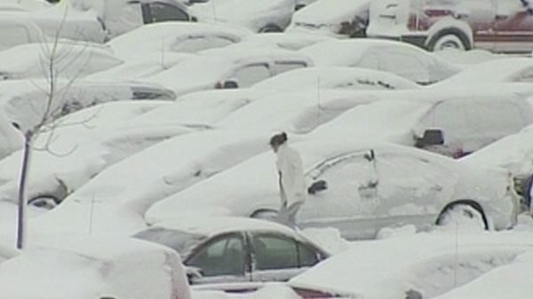 In this undated photo, travellers can be seen trying to dig their car out of the snow after returning from vacation at an airport in N.B.