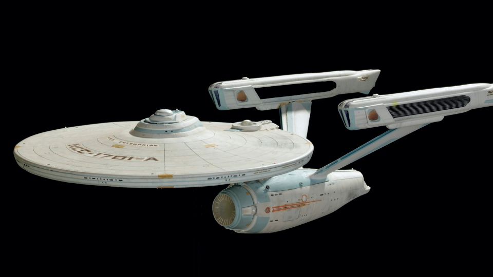 This photo shows a miniature model of the Starship Enterprise. In celebration of the 40th anniversary of Star Trek, Christie's conducted an auction f more than 1,000 items from the archives of CBS Paramount Television Studios. (AP / Christie's)