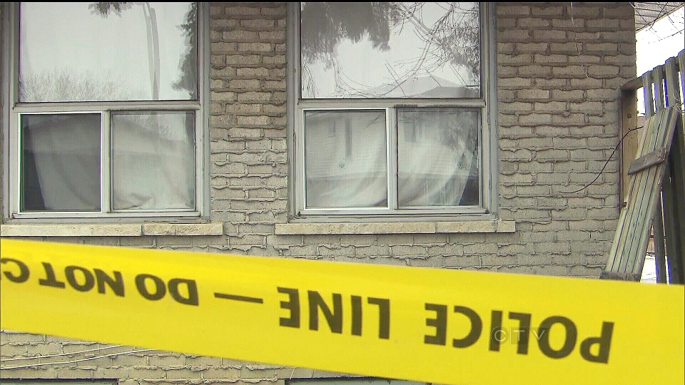 Police tape surrounds the home where nine-year-old Kesean Williams was fatally shot in Brampton, Ont., Friday, Jan. 25, 2013.