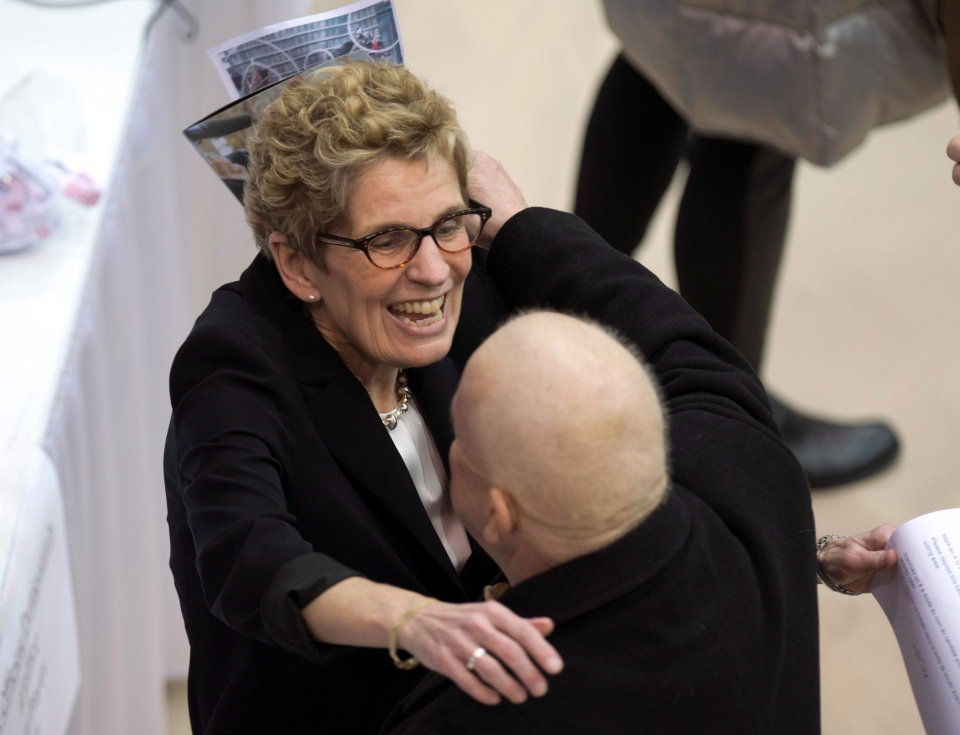 Ontario Liberal Party leadership candidate Kathleen Wynne hugs a delegate as she registers to vote at the leadership convention in Toronto on Friday, Jan. 25, 2013. (Frank Gunn / THE CANADIAN PRESS)