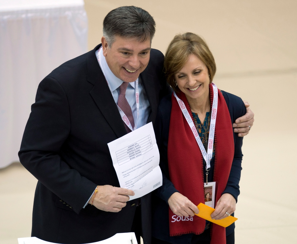 Ontario Liberal Party leadership candidate Charles Sousa holds his ballot as he poses with his wife Zenaida after voting at the convention in Toronto on Friday, Jan. 25, 2013. (Frank Gunn / THE CANADIAN PRESS)