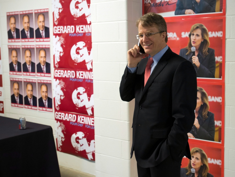 Ontario Liberal Party leadership candidate Gerard Kennedy talks on his phone at the leadership convention in Toronto on Friday, Jan. 25, 2013. (Frank Gunn / THE CANADIAN PRESS)