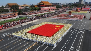 The phalanx of the Chinese national flag receives inspection in a parade in Beijing during the celebrations for the 60th anniversary of People's Republic of China on Oct. 1, 2009. (Xinhua / Huang Jingwen, File)