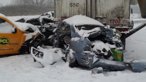 The aftermath of a multi-vehicle collision is seen on the Highway 401 westbound lanes near Newcastle, Ont.,  Friday, Jan. 25, 2013. (Dave Parsons / CTV News)
